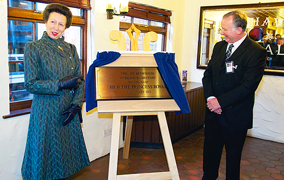 HRH The Princess Royal opens the brewhouse as George Howell looks on.