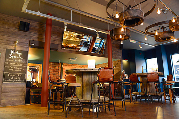 """Munro's interior blends traditional and industrial materials in a """"shabby chic"""" design."""