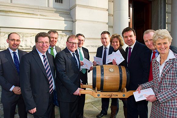Message in a barrel: Brigid Simmonds (right) delivers calls for a duty freeze.