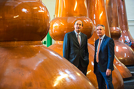 Chivas Brothers chairman and chief executive Christian Porta with Richard Lochhead MSP in the still house.