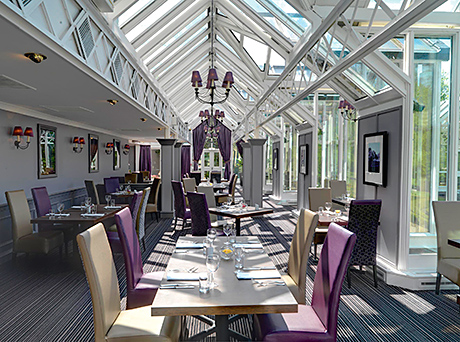 The Maze Restaurant is located in a glass house overlooking the six-acre gardens, which feature a maze and fountain.