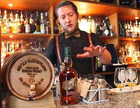 Kyle Jamieson prepares his winning cocktail, the Kentucky Reviver #113.
