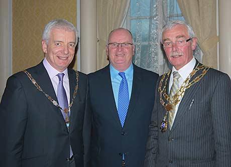 • SLTA chairman Peter Lederer (left) with John Gilligan and SLTA president Eric Montgomery.