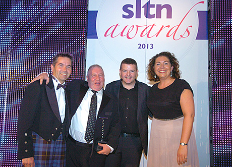 • Stuart Clarkson (above second from left) picks up the SLTN Award for Industry Achievement, in association with Maxxium UK, from Maxxium's Huw Pennell, Kevin Bridges and SLTN editor Gillian McKenzie before the party gets underway.