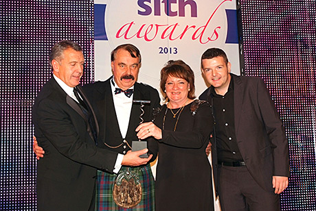 The team collect their SLTN Awards.