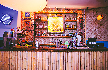 • Pacific's bar is smaller than the one at Tiki Bar, but retains some of the same style.