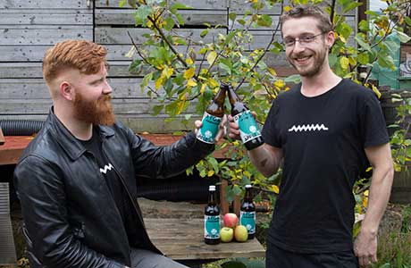• Chris Moriarty and Jake Griffin of Drygate with the craft brewer's Outaspace Apple Ale.