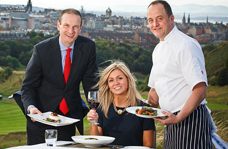 • Tom Falconi (right) serves up a feast with hotel manager Stuart Broomfield.