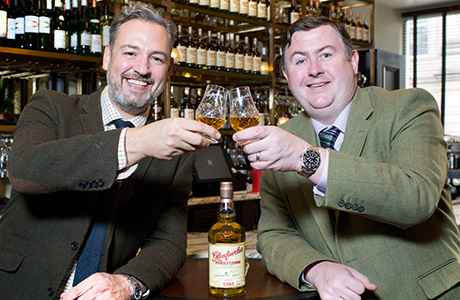 • Hutchesons owner James Rusk (left) and George Grant of Glenfarclas toast new partnership.