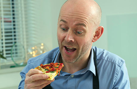 • Chef Dave Gannon sampling one of his currizzas.