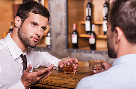 042shutterstock_two guys drinking whisky