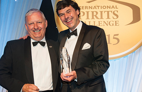 • Dr Bill collects his award.
