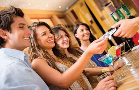 shutterstock_paying for drinks at bar