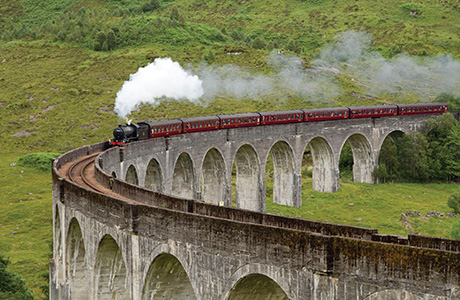 The Jacobite steam train passing over the Glenfinnan Viaduct at the head of Loch Shiel, Lochaber, Highlands of Scotland Picture Credit : Paul Tomkins / VisitScotland