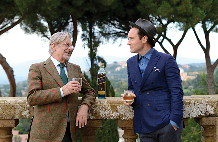 Giancarlo Giannini and Jude Law attend the Johnnie Walker Blue Label photocall for 'The Gentleman's Wager II' at Villa Mondragone on October 31, 2015 in Rome, Italy.