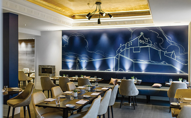• A mural by artist Nichol Wheatley dominates the new-look eatery.