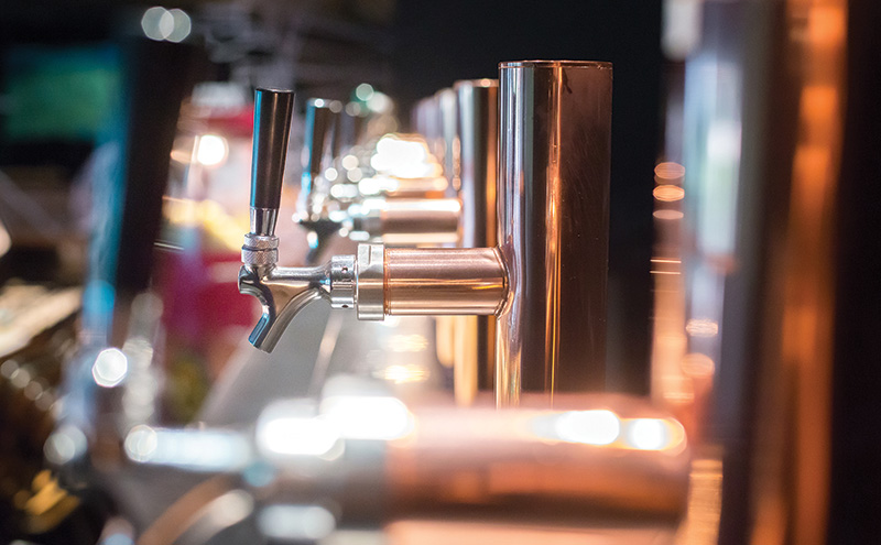 018_shutterstock_beer taps in a row