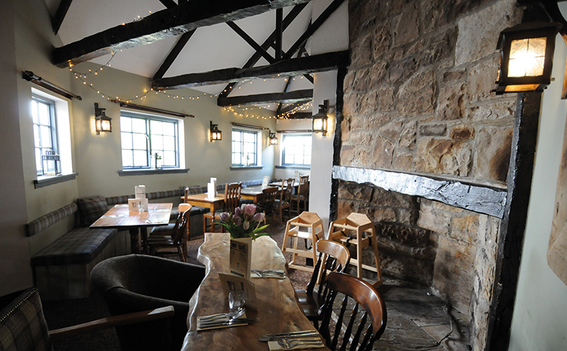 A modern, rustic aesthetic flows throughout the new pub