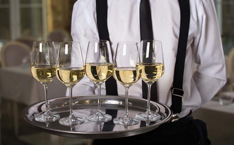 shutterstock_waiter with wine glasses