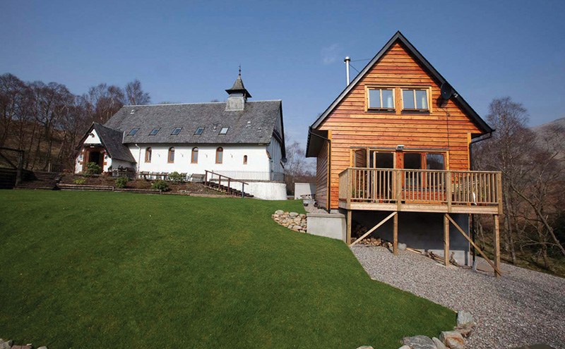 • The business operates out of a converted 19th century church; a recently-built log cabin (pictured) is included in the sale.