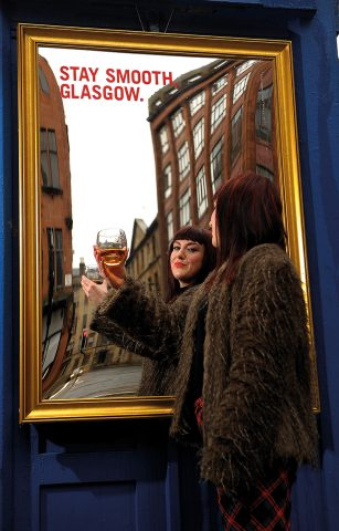 Whyte & Mackay Mirror Laura Cameron poses in front of the Whyte & Mackay mirror in Glasgow's Merchant City. 28/9/16 Picture © Andy Buchanan 2016