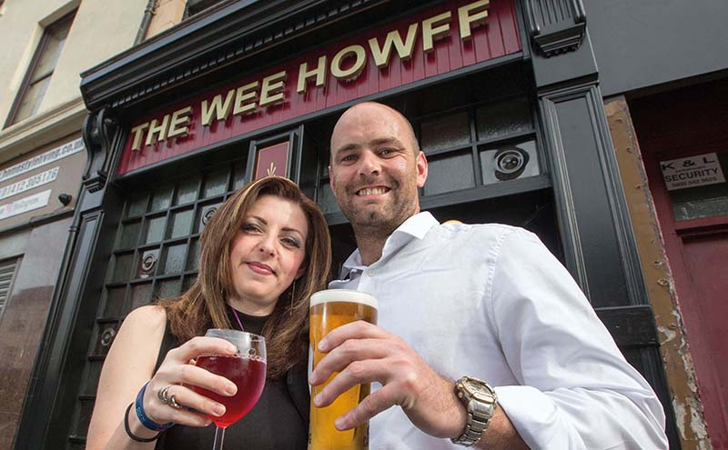 Lisa and George raise a glass to their new careers at the helm of the pub.