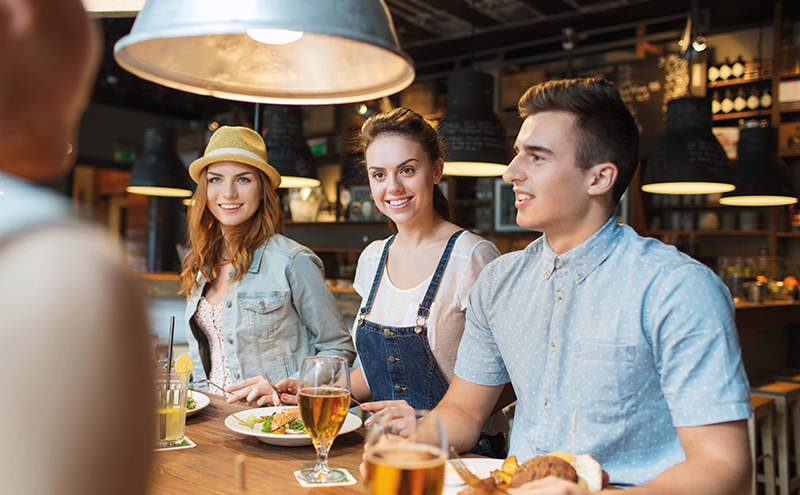 Young people eating in bar