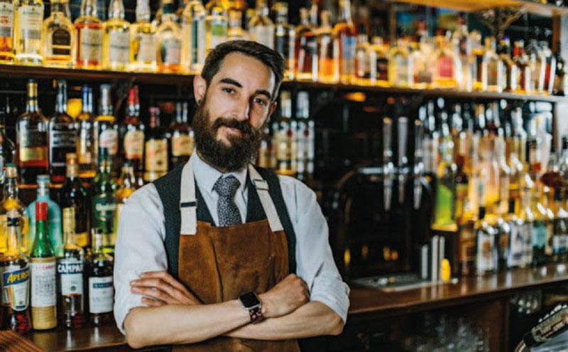AJ McMenemy behind the bar at The King of Islington