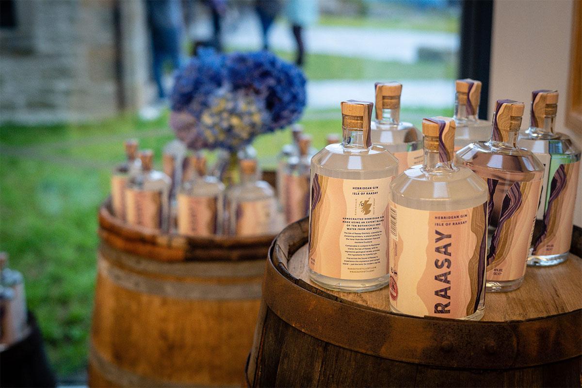 Bottles of Raasay Gin on barrels