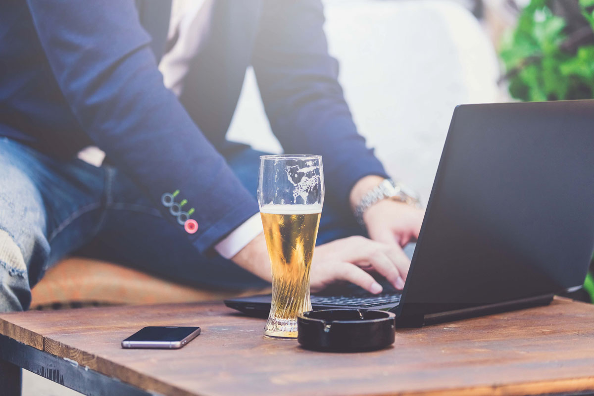 guy on laptop with pint